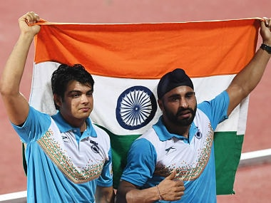 India's Neeraj Chopra (L) and Davinder Singh Kang celebrate after placing first and third, respectively, in the javelin throw event during the final day of the 22nd Asian Athletics Championships on July 9, 2017 at Kalinga Stadium in Bhubaneswar. / AFP PHOTO / Dibyangshu SARKAR