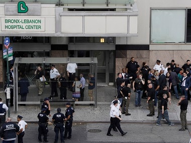 Officials are gathered outside Bronx Lebanon Hospital Center after reports of a shooting. AP