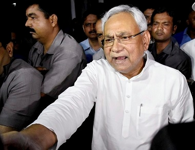 Nitish Kumar speaks to the media after meeting Governor KN Tripathi. PTI
