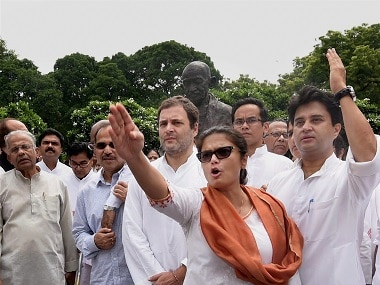 Opposition leaders protest in front of the Mahatma Gandhi statue. PTI