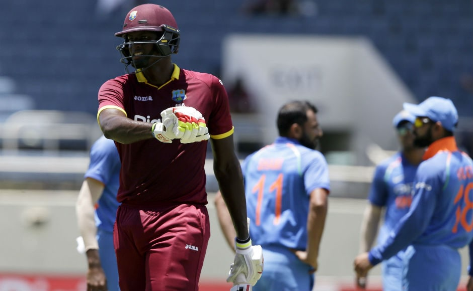 Windies captain Jason Holder leaves the field after being dismissed during the 5th ODI of the series against India at the Sabina Park in Kingston, Jamaica. AP
