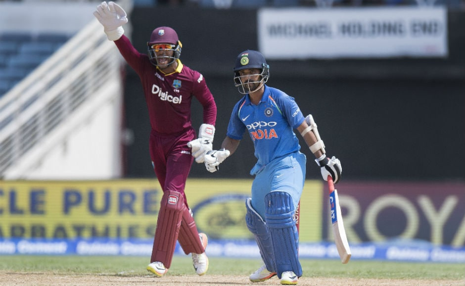Windies wicket-keeper Shai Hope (L) calls for a leg before wicket on India's Ajinkya Rahane during the 5th ODI of the series against the Windies at Sabina Park in Kingston, Jamaica. AFP