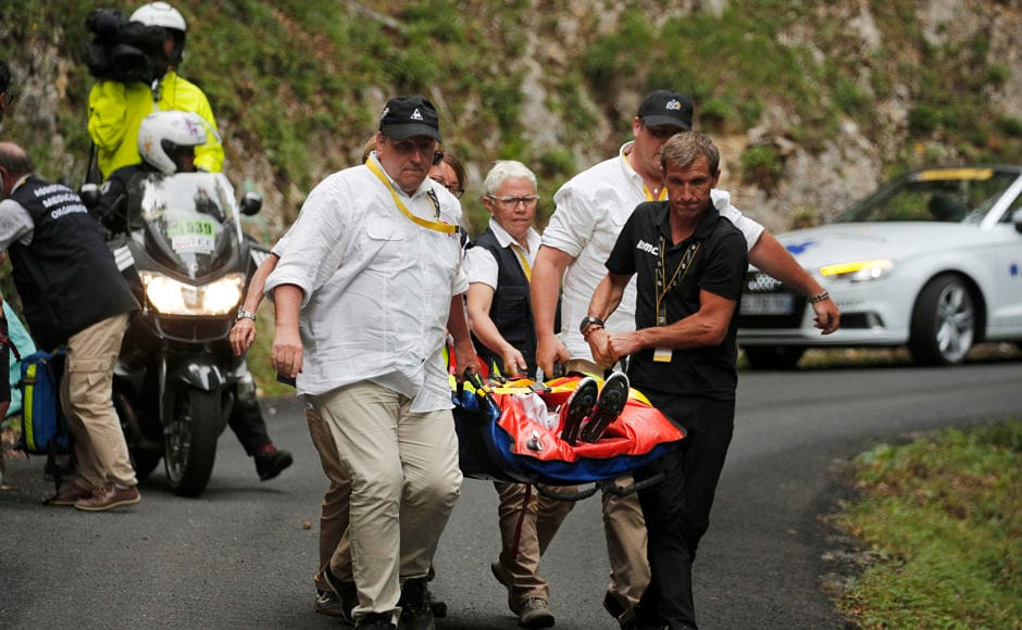 Australia's Richie Porte is carried to an ambulance. Porte, said to be out of danger, has been ruled out of Tour de France. AP