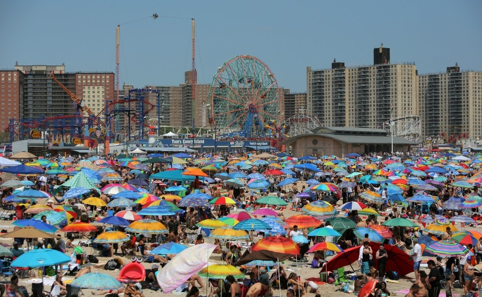 While there were several parades and concerts across America, beachgoers at Coney Island Beach in New York City celebrated the Independence Day out in colourful tents. Reuters