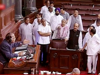 Opposition Congress members protest in the Rajya Sabha. PTI