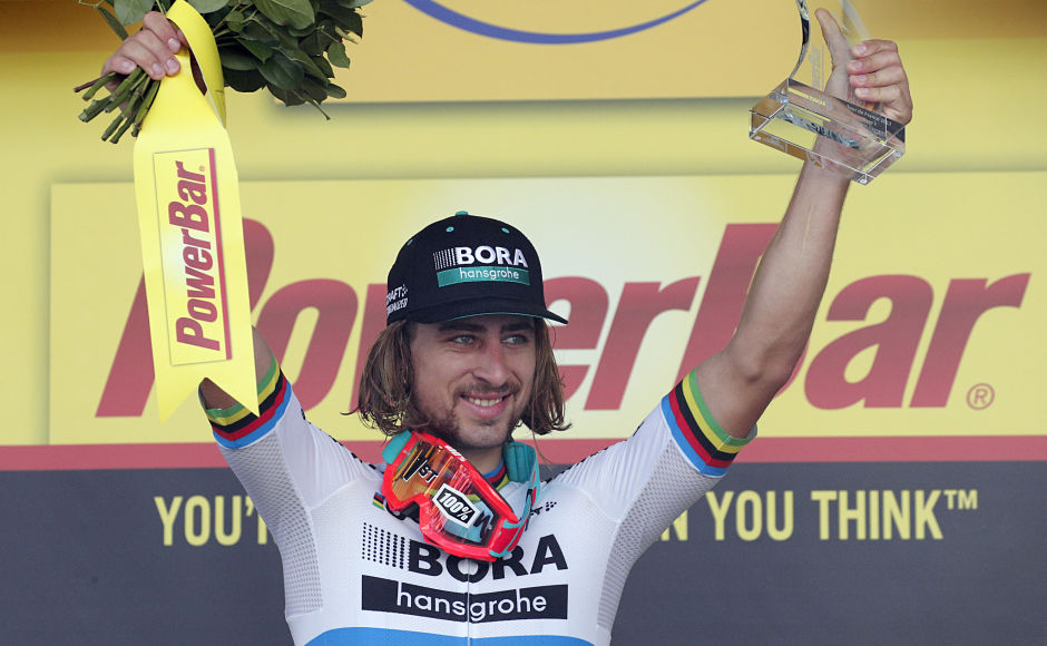 Stage winner Peter Sagan of Slovakia celebrates on the podium after the third stage of the Tour de France. AP