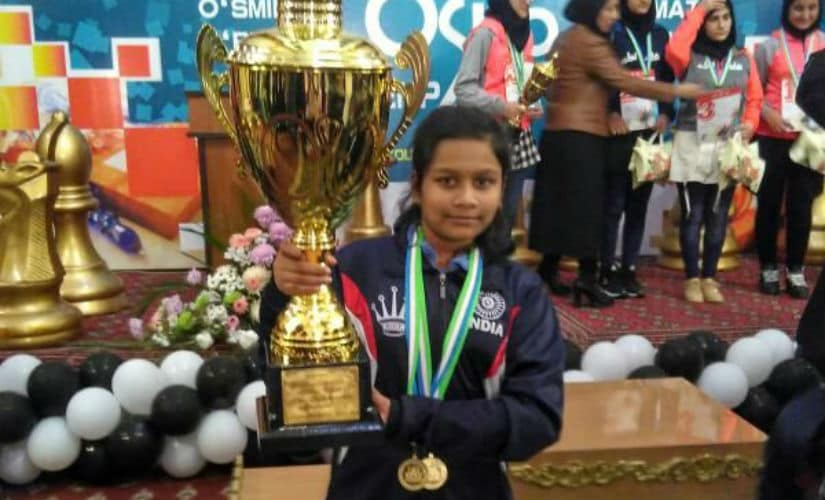Sahithi with two gold medals (classical and blitz) and the trophy in the Asian Youth Chess Championship.
