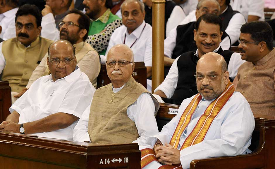 Seated in the front row were NCP leader Sharad Pawar, BJP president Amit Shah and senior BJP leader LK Advani. PTI