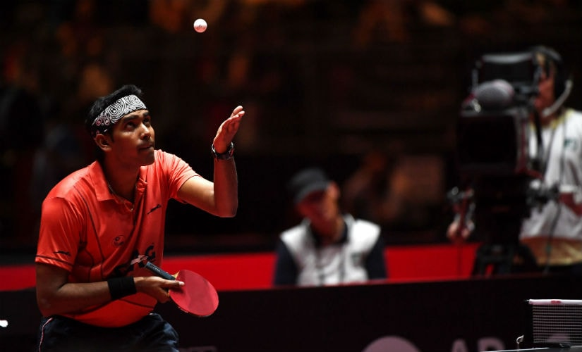 Sharath Kamal plays the ball during his third round men´s singles match against Chinese Gaoyuan Lin during the WTTC World Table Tennis Championships in Duesseldorf, on 2 June, 2017. AFP