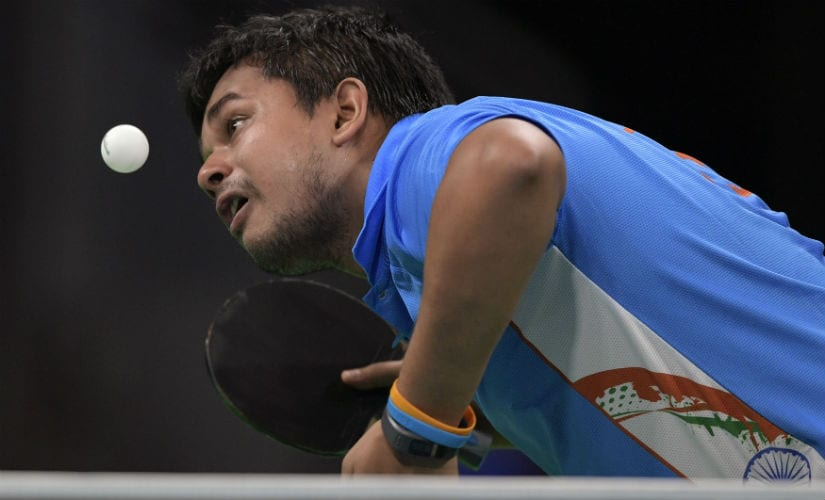 Soumyajit Ghosh eyes the ball in his men's singles qualification round table tennis match at the Riocentro venue during the Rio 2016 Olympics. AFP
