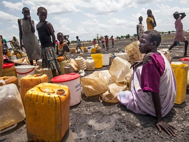 Displaced women queue to collect water from a new water point in Aburoc South Sudan on June 5, 2017. Getty Images