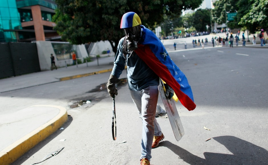 Protesters are often seen carrying make-shift weapons. The fear of a return to the pre-Chavez era is felt strongly by those who still support the government, many of whom live in the slums. AP