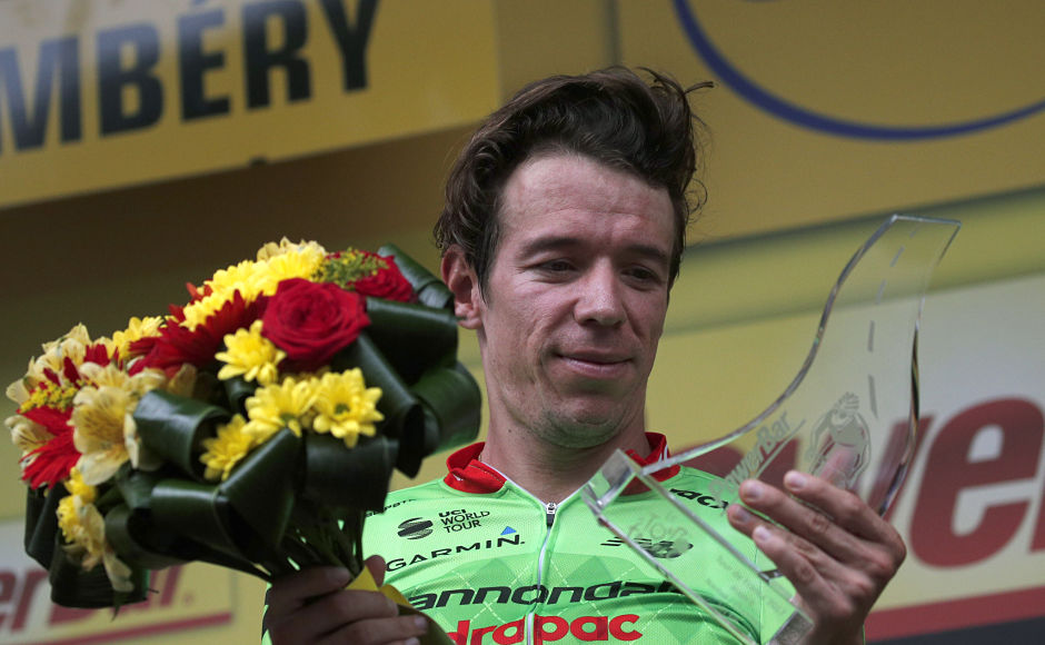 Colombia's Rigoberto Uran celebrates on the podium after winning the ill-fated ninth stage of the Tour de France cycling race. AP