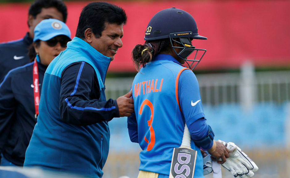India's Mithali Raj is congratulated by coach Tushar Arothe after her dismissal. Reuters
