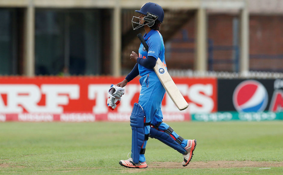 Punam Raut walks back dejected after she was dismissed early, for a paltry four. Reuters