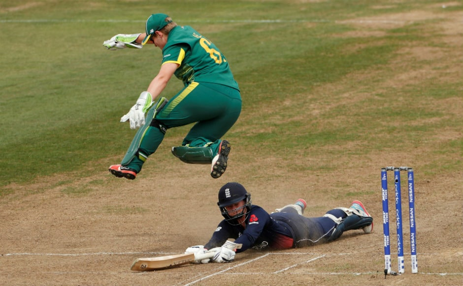 South Africa's Lizelle Lee attempts to run out England's Tammy Beaumont in the first semi-final of the Women's World Cup. England fended off a spirited South Africa by two wickets to move to the finals. Reuters