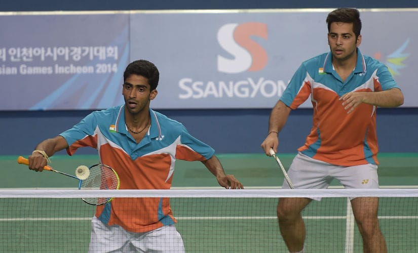 India's Buss Sumeeth Reddy (L) and Attri Manu (R) return a shot against Indonesia's Ahsan Mohammad and Setiawan Hendra during their badminton men's doubles quarter-final round match at the 2014 Asian Games in Incheon on September 26, 2014. AFP PHOTO / PORNCHAI KITTIWONGSAKUL / AFP PHOTO / PORNCHAI KITTIWONGSAKUL