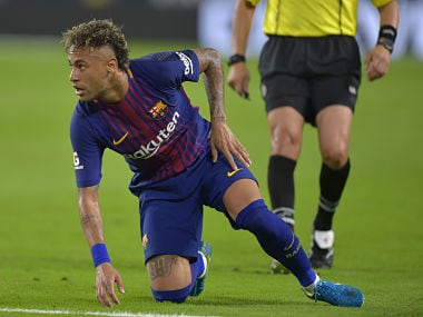 Neymar of Barcelona watches his shot during their International Champions Cup football match against Real Madrid at Hard Rock Stadium on July 29, 2017 in Miami, Florida. / AFP PHOTO / HECTOR RETAMAL