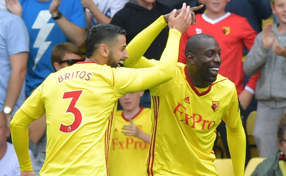 Watford's Italian striker Stefano Okaka celebrates scoring the opening goal during their English Premier League football match against Liverpool at Vicarage Road Stadium in Watford, AFP