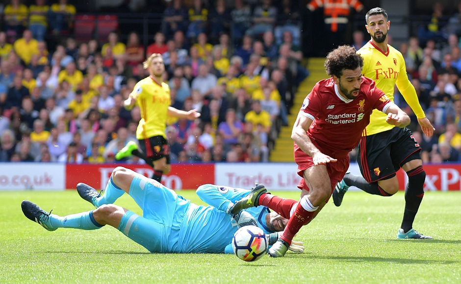 In the second half, Watford's Brazilian goalkeeper Heurelho Gomes fouled Liverpool's Egyptian midfielder Mohamed Salah to concede a penalty. AFP