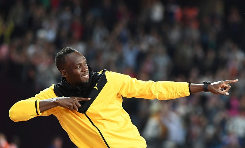 Usain Bolt does his trademark gesture as he takes part in a lap of honour on the final day of the 2017 IAAF World Championships. AFP
