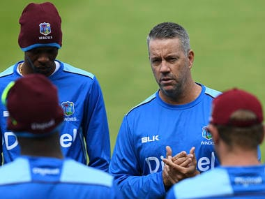 "West Indies coach Stuart Law (R) takes part in a training session on the eve of the first day of the first cricket Test Match between England and the West Indies at Edgbaston in Birmingham, central England on August 16, 2017. West Indies coach Stuart Law hopes his side can ""rewrite history"" during a Test series in England. The first of a three-match campaign gets underway at Edgbaston on August 17 with the inaugural day/night Test ever staged in England. / AFP PHOTO / Paul ELLIS / RESTRICTED TO EDITORIAL USE"