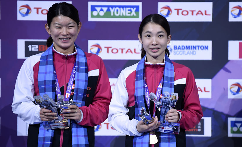 Japan's Misaki Matsutomo and Ayaka Takahashi pose on the podium after receiving their bronze medals for the women's doubles during the 2017 BWF World Championships. AFP