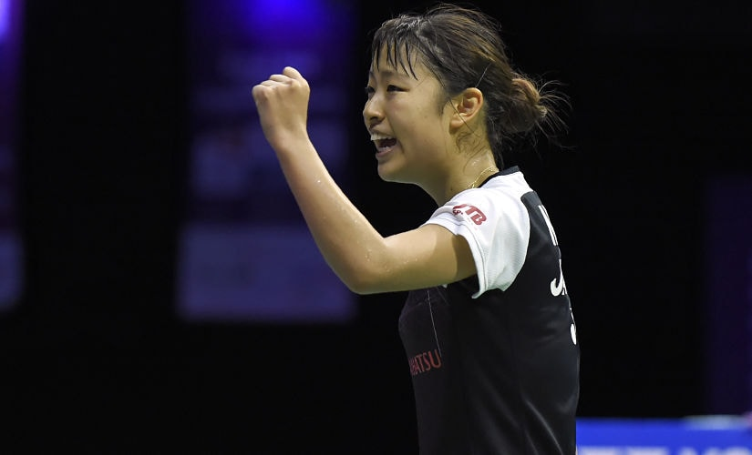 Japan's Nozomi Okuhara celebrates after her victory over India's Sindhu Pusarla in their women's singles final match of the 2017 BWF World Championships. AFP