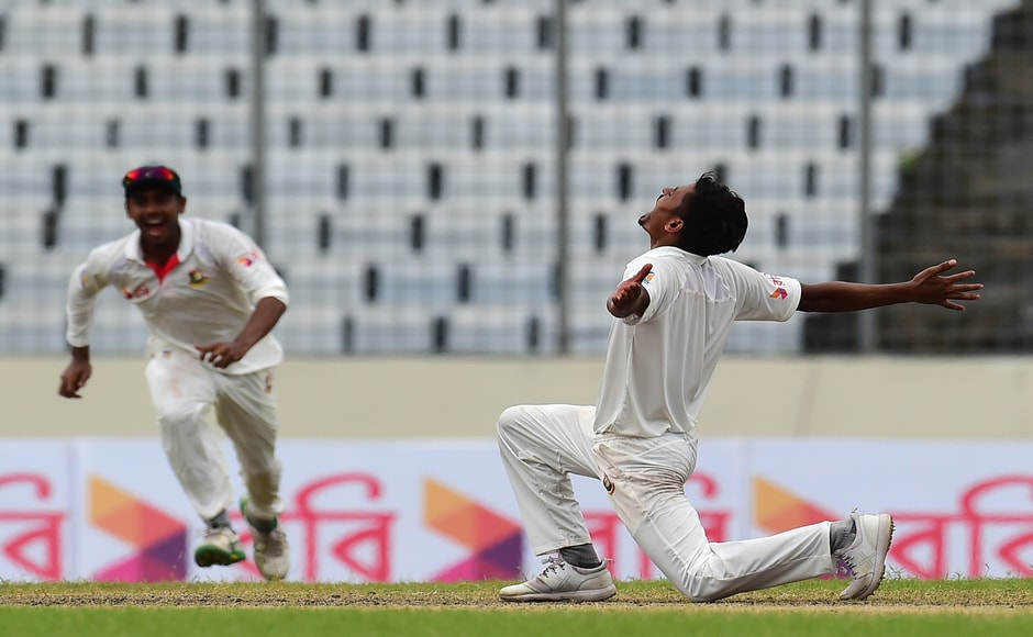 Taijul Islam celebratesafter taking the last wicket of Josh Hazlewood to record a stunning 20-run victory over the mighty Aussies. AFP
