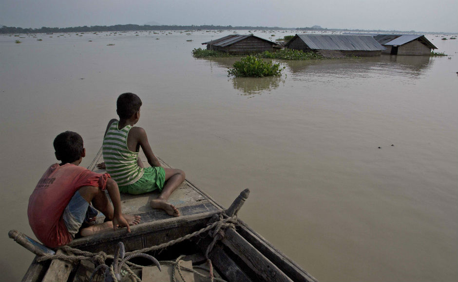 Floods ravaged Assam, West Bengal, Bihar and North East India affecting millions amid torrential rains. AP