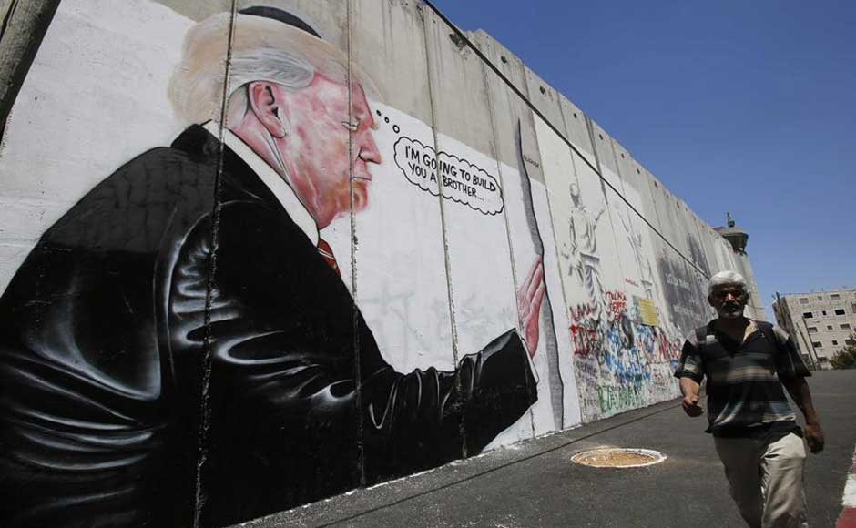 Two murals showing an oversized US president Donald Trump appeared Friday on Israel's West Bank separation barrier, just yards from where Banksy decorated a hotel earlier this year. The new drawings which resemble Banksy's earlier art popped up on the edge of Bethlehem, the Palestinian city where the barrier largely consists of a wall of towering slabs of concrete. AFP