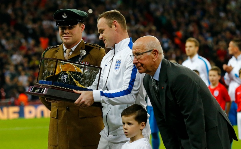 Wayne Rooney poses for a photo after having achieved the milestone of representing England 100 times. He subsequently was awarded by Sir Bobby Charlton for the same. Reuters