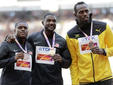 Christian Coleman, silver, Justin Gatlin, gold, and Usain Bolt, bronze, from left, during the medal ceremony. AP