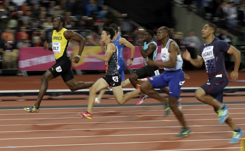 Usain Bolt was slow out of the blocks, but his massive stride easily made up the deficit. From the 70-meter mark, he made it look easy coasting to victory in his first-round heat of the 100 meters. AP