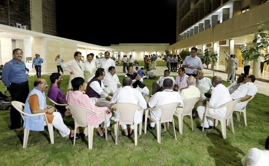 Bharatiya Janata Party MLAs outside the counting centre of Rajya Sabha election votes at Gandhinagar on Tuesday. Counting of votes were suspended for seven hours following Congress seeking disqualification of votes from two rebel MLAs. PTI