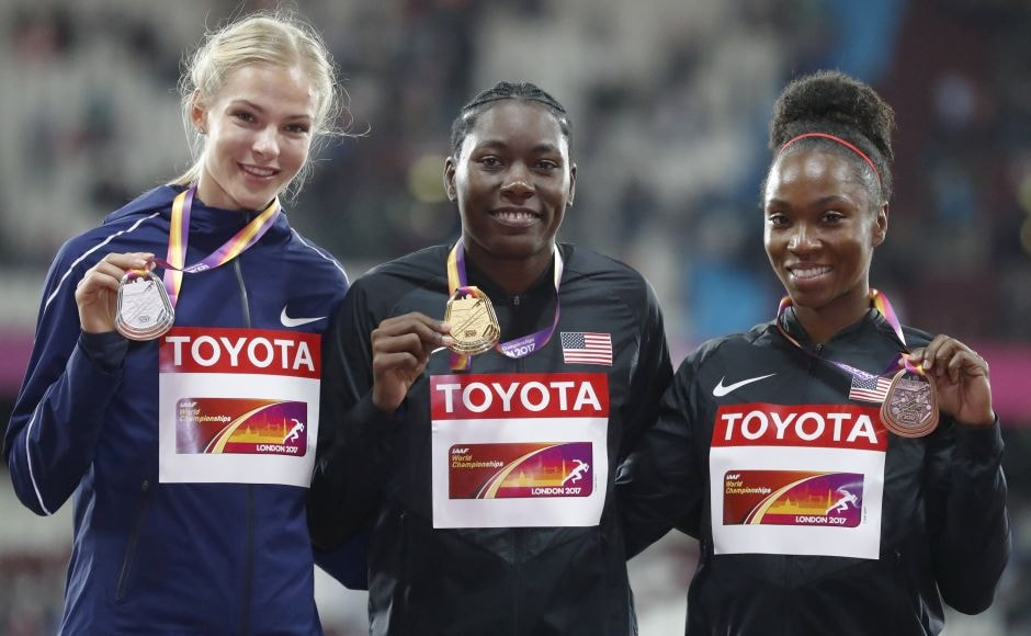 Silver medallist Darya Klishina (L), gold medallist Brittney Reese (centre) and bronze medallist Tianna Bartoletta (R) smile during the medal ceremony for the women's long jump during the IAAF World Championships in London. AP