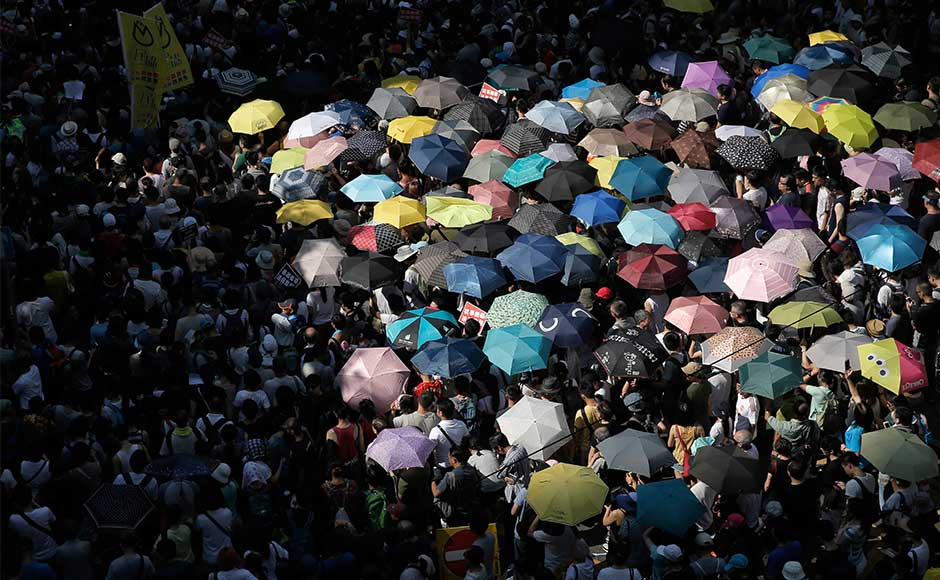 After three young democracy activists were jailed in Hong Kong, thousands of supporters took to the streets on Sunday to protest their sentences. Joshua Wong, Nathan Law and Alex Chow — leaders of the 'Umbrella Movement' rallies from 2014, were sentenced to six to eight months in jail for their role in a protest that sparked months' long demonstrations calling for democratic reforms. AP