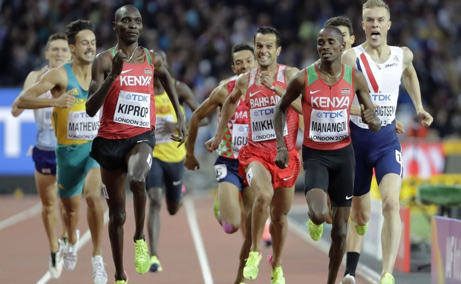 Kenya's Asbel Kiprop (L) stayed on course for a fourth straight world title in the 1,500 metres, coming from way back with a strong final kick to qualify for Sunday's final. Kiprop finished just behind Kenyan teammate Elijah Manangoi (R) to go through as automatic qualifiers. AP