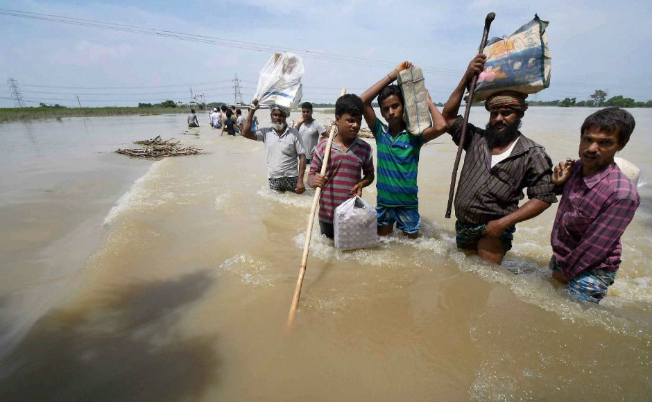 "Bihar chief minister Nitish Kumar has expressed concern over the ""grim situation"" and said the flood was caused by incessant rains in Nepal, India's upper riperian neighbour. He also conducted an aerial survey of flood-hit areas. PTI"