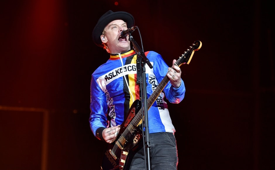 Matt Skiba of Blink 182 performing to a packed audience at Lollapalooza music fest in Chicago.