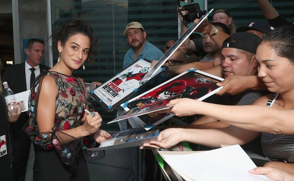 Actor Jenny Slate autographs merchandise for fans present at the Los Angeles premiere of Comrade Detective. Image from Facebook