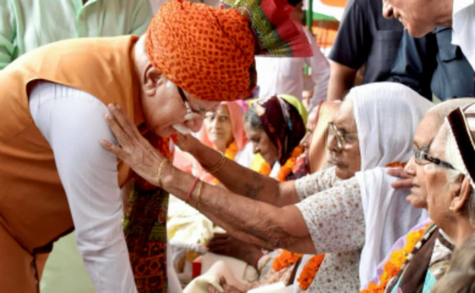 Haryana chief minister Manohar Lal Khattar honoured the family members of freedom fighters at a function at Tau Devi Lal Stadium to celebrate Independence Day, in Gurugram. PTI