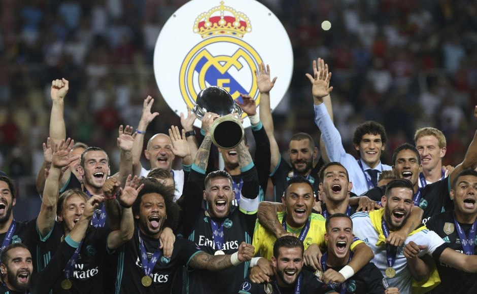 Real Madrid celebrate with the trophy after defeating Manchester United in the UEFA Super Cup final soccer match at Philip II Arena in Skopje. AP