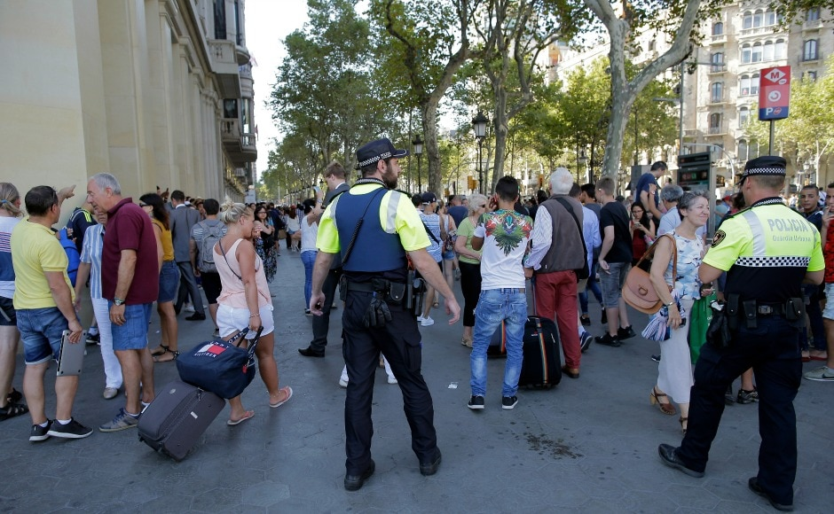 Two armed men reportedly entered a restaurant in Las Ramblas after the crash, reports said. AP