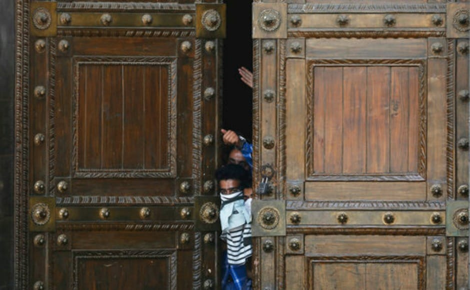 Several masked Kashmiri Muslim protesters on Friday shouted anti-India slogans at the entrance of Jamia Masjid in Srinagar. AP