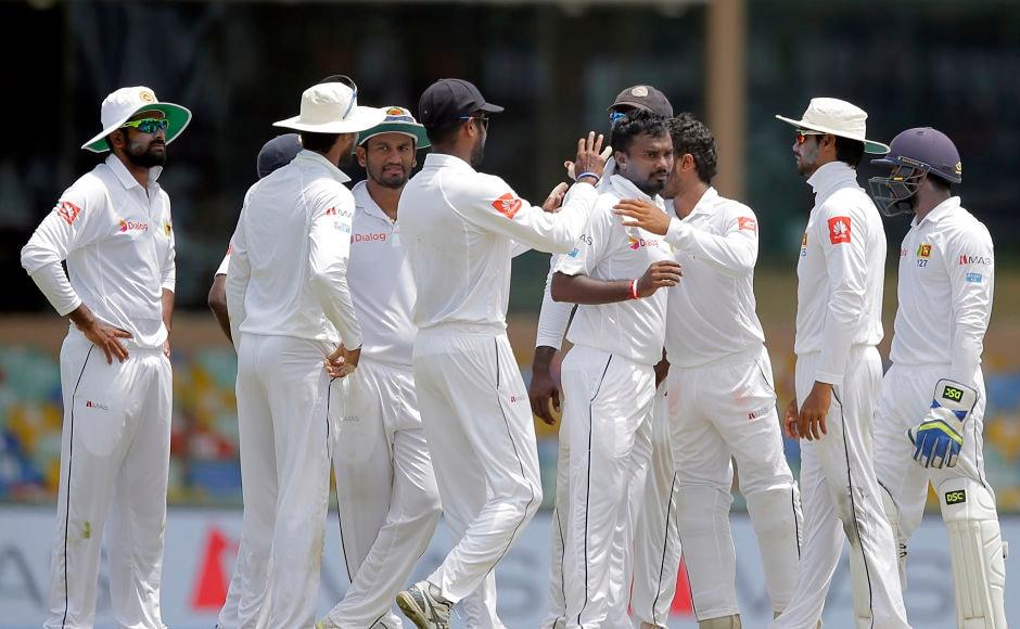 Sri Lanka's Malinda Pushpakumara too scalpedhis maiden Test wicket dismissingIndia's Ajinkya Rahane stumped. AP