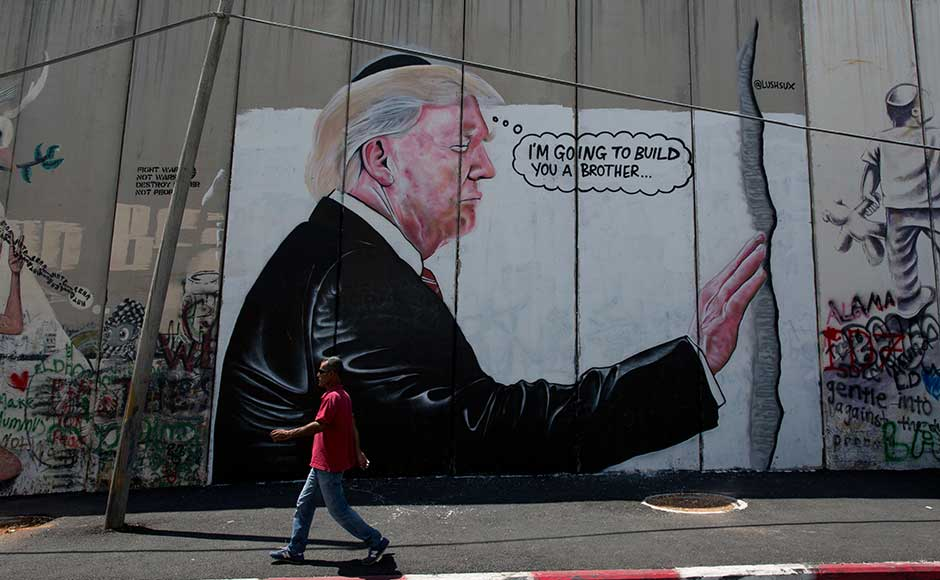 In another drawing, Trump is depicted wearing a Jewish skullcap and placing a hand a wall — a scene taken from the US president's May visit to Jerusalem's Western Wall, the holiest site where Jews can pray. A cartoon