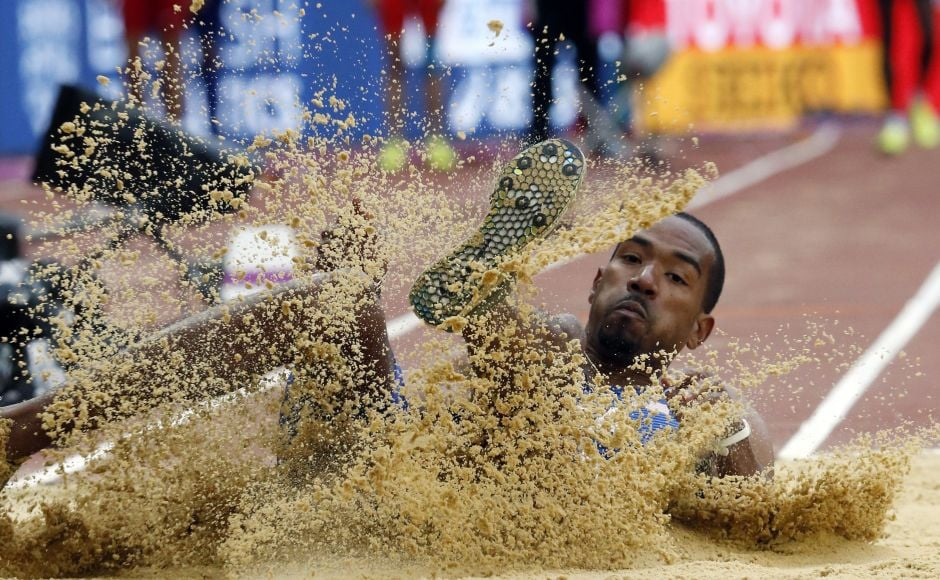 With the automatic qualifying standard set at 17 meters, American Christian Taylor hit 17.15 right away and reached Thursday's triple jump final at the world championships. AP