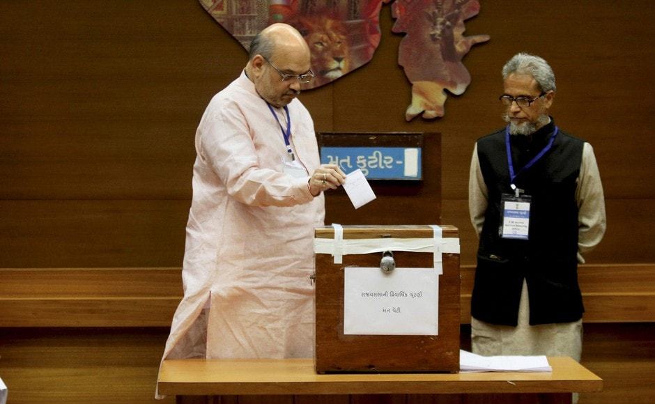 BJP national president Amit Shah casts his vote for Rajya Sabha election at the Secretariat in Gandhinagar on Tuesday. PTI