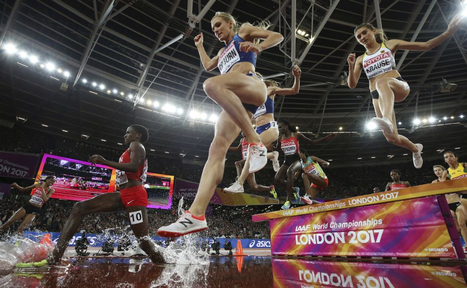 Emma Coburn took the lead for good at the final water jump and kicked for home to finish in a championship record of 9 minutes, 2.58 seconds. Courtney Frerichs was 1.19 seconds behind, holding off Hyvin Jepkemoi in a sprint finish. AP